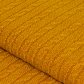 Curry coloured cashmere blanket in cable knit